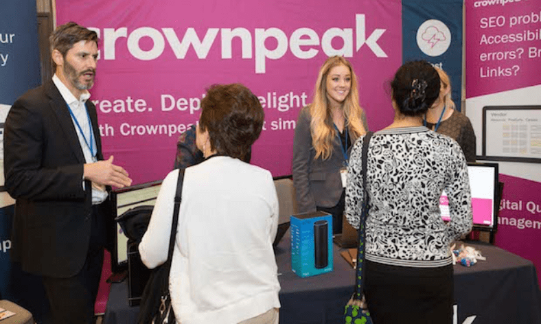 People talking at a tradeshow booth